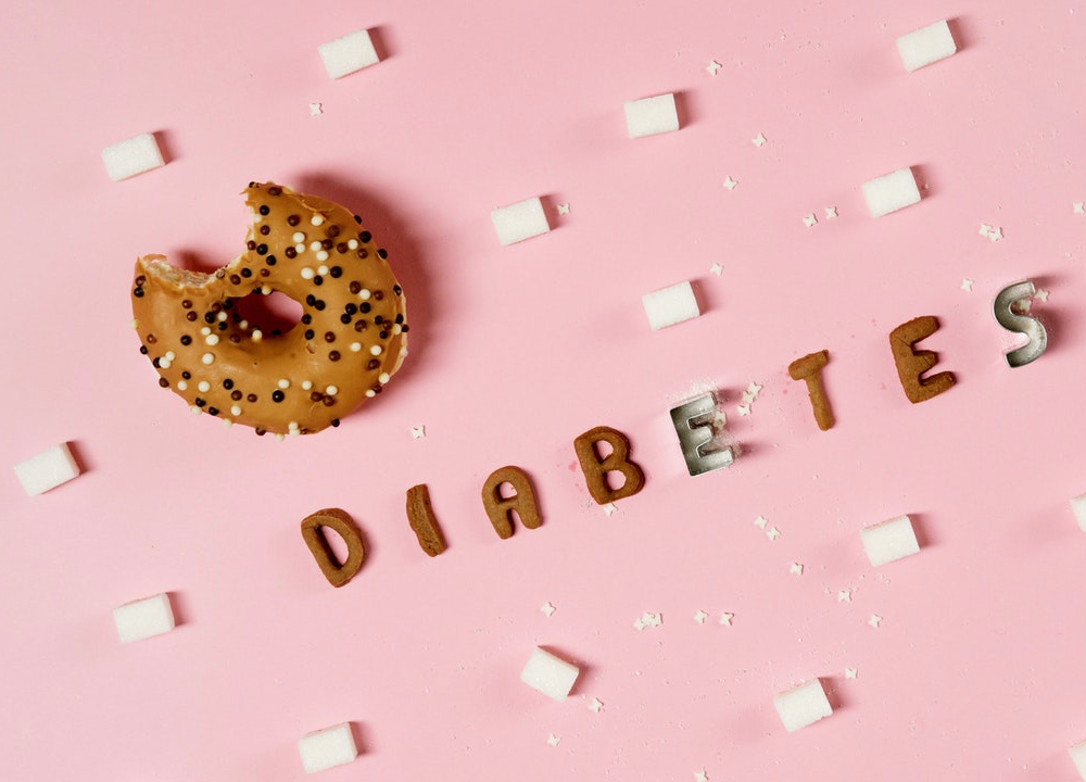 Sugar cubes, a donut, and the word Diabetes draw attention to its relationship with Calcium ATPase